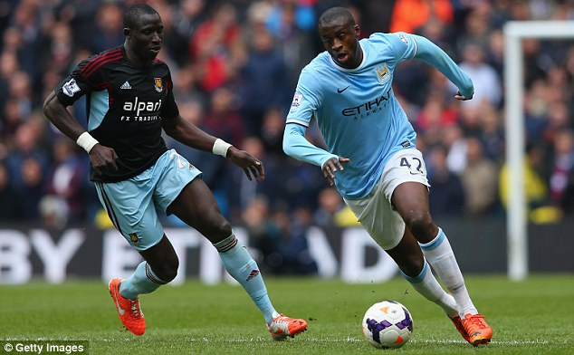 Fanciful: Yaya Toure's agent has claimed his client (right) would have won more awards were he white