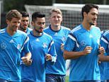 Germany's national football team's midfielder Bastian Schweinsteiger (C) runs with teammates during a training session in Frankfurt, western Germany on September 2, 2015 prior to the Euro 2016 qualifier football game Germany vs Poland on September 4, 2015.  AFP PHOTO / DANIEL ROLANDDANIEL ROLAND/AFP/Getty Images