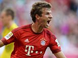 Bayern Munich's striker Thomas Mueller celebrates after scoring the first goal for Munich during the German first division Bundesliga football match Bayern Munich vs Bayer 04 Leverkusen in Munich, southern Germany, on August 29, 2015.  AFP PHOTO / CHRISTOF STACHE RESTRICTIONS: DURING MATCH TIME: DFL RULES TO LIMIT THE ONLINE USAGE TO 15 PICTURES PER MATCH AND FORBID IMAGE SEQUENCES TO SIMULATE VIDEO.  == RESTRICTED TO EDITORIAL USE == FOR FURTHER QUERIES PLEASE CONTACT DFL DIRECTLY AT + 49 69 650050.CHRISTOF STACHE/AFP/Getty Images