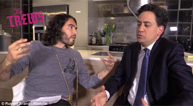 In a trailer released on Tuesday night, Russell Brand challenges Ed Miliband to take action on global tax avoidance at a time when workers are paying 10 times as much tax as firms like Amazon