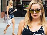 Kate Hudson leaves her hotel in New York September 4, 2015\n\nPictured: Kate Hudson\nRef: SPL1116352  040915  \nPicture by: NIGNY / Splash News\n\nSplash News and Pictures\nLos Angeles: 310-821-2666\nNew York: 212-619-2666\nLondon: 870-934-2666\nphotodesk@splashnews.com\n
