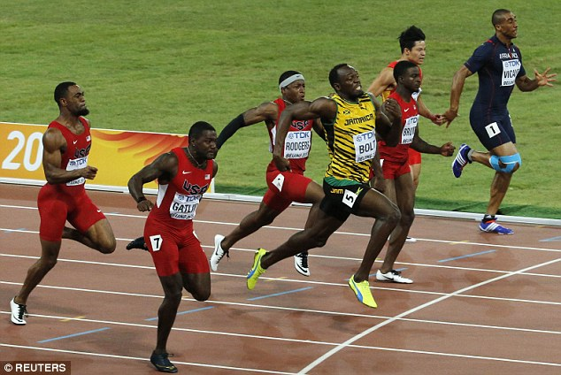 Bolt crosses the line ahead of rival Gatlin (second left) in the highly-anticipated 100m race