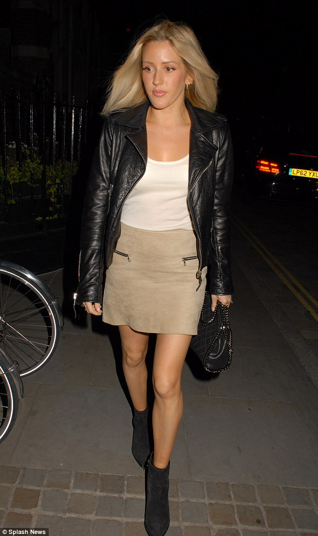 Stylish outing: Ellie Goulding donned a suede miniskirt to party the night away at the Chiltern Firehouse in London on Thursday evening, having roused suspicion that she's recording the Bond theme