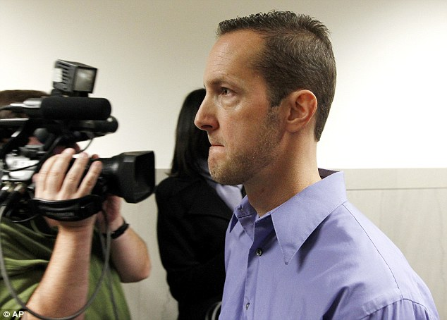 Fines: Two ex-Milwaukee police officers including Jeffrey Dollhopf , pictured, have been given $300 fines for their roles in a sordid string of illegal anal cavity probes inflicted on male suspects