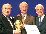 FIFA President Joseph Blatter, left, Franz Beckenbauer CEO President Germany 2006, center, and Fedor Radmann, delegate of the coordination for the bid to host the 2006 soccer World Cup, pose for photographers after a press conference in Zurich Wednesday, July 6, 2000. Germany won with 12-11 votes against South Africa. (AP photo/Walter Bieri)...S...SOC