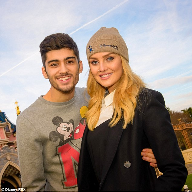 In happier times: Zayn pictured with Perrie at Disneyland in Paris in 2014