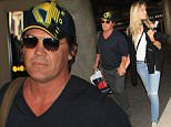 4 September 2015.\nJosh Brolin and Kathryn Boyd are seen at LAX.\nCredit: BG/GoffPhotos.com   Ref: KGC-300/150904NR9\n**UK, Spain, Italy, China, South Africa Sales Only**