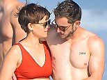 EXCLUSIVE: Kate Mara packs on the PDA with her new boyfriend Jamie Bell. The pair were seen taking a romantic stroll on the beach with Kate's dog. The couple were seen walking for nearly half an hour and never let go of each other, except for when Kate was seen grabbing her dog and leashing him up after he had wandered off a little too far. they constantly looked into each other's eyes and kept their arms around each other and looked extremely happy and comfortable together.