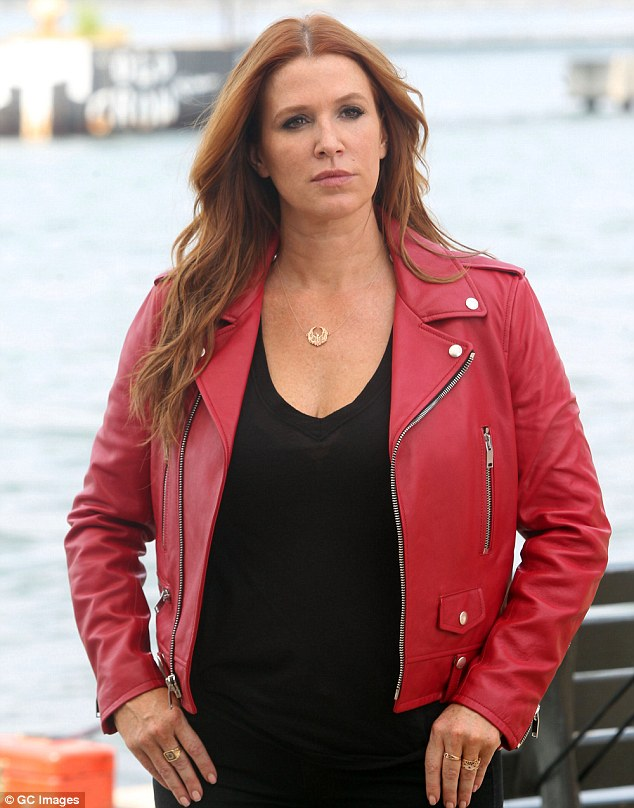 Back on set: Poppy Montgomery rocked a red leather jacket as she filmed scenes for the crime drama Unforgettable in New York