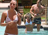 Chloe Madeley seen in a white bikini whilst on holiday with boyfriend James Haskell in Dubai