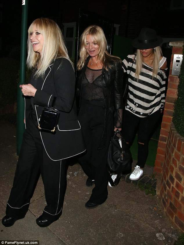 Sticking with it: Supermodel Kate Moss continued to wear the revealing garment she wore earlier in the evening