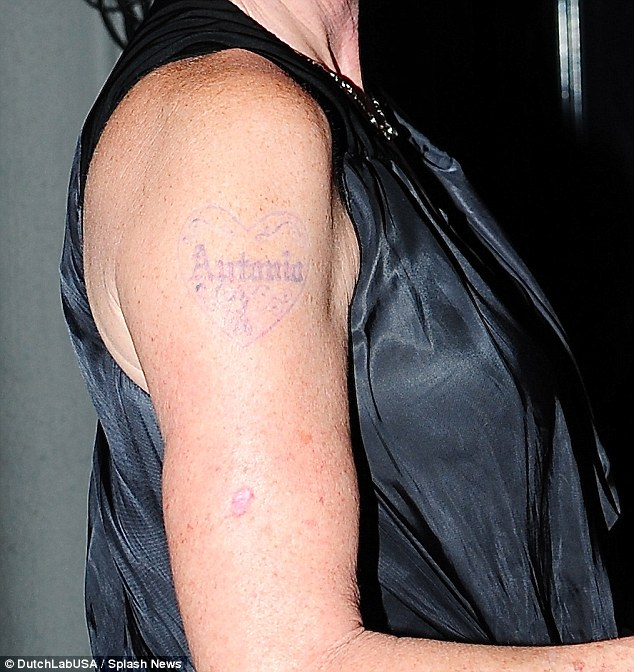 Barely there:Griffith opted for laser tattoo removal after her divorce from Antonio Banderas