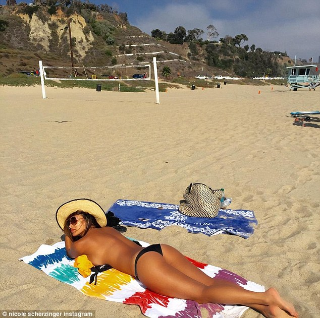 Wowza! Nicole Scherzinger showed off her stunning figure in a topless sunbathing snap this week