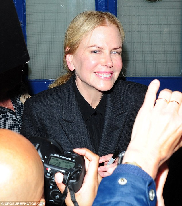 Genuine: Nicole seemed to enjoy being greeted her fans outside the stage door and posed for pictures