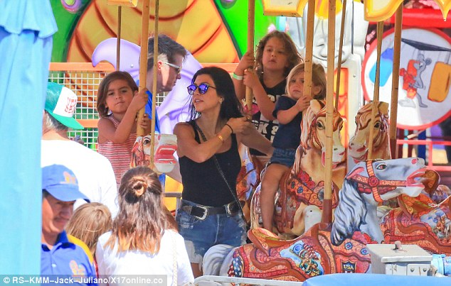 Fun at the fair: Kourtney took her two eldest kids to the carnival in Malibu