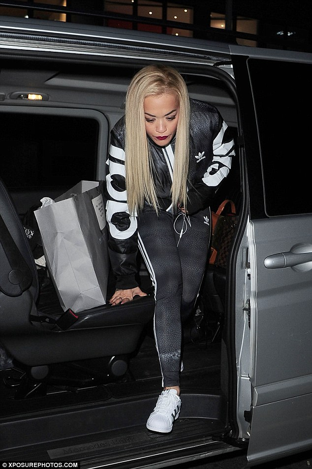 Sporty: With her long, blonde tresses hanging loose for her appearance at the high street store, Rita looked in her element, proudly modeling her own line of Adidas clothing