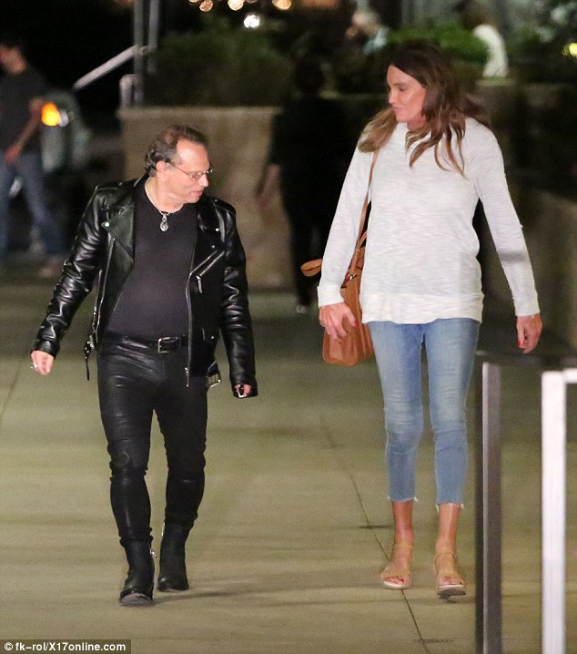 Dinner for two: Caitlyn Jenner was seen enjoying a late night dinner outing with writer Buzz Bissinger on Friday night