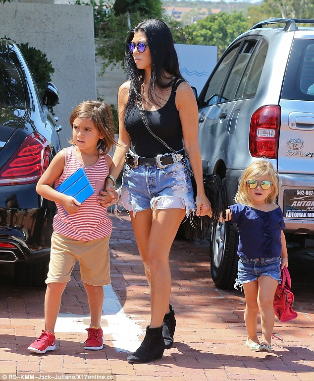 Sultry stunner: Kourtney Kardashian showed off her remarkable slimmed down physique in rugged cut-outs and a tank top while out to lunch in Calabasas, CA with her children Mason, six, and Penelope, three