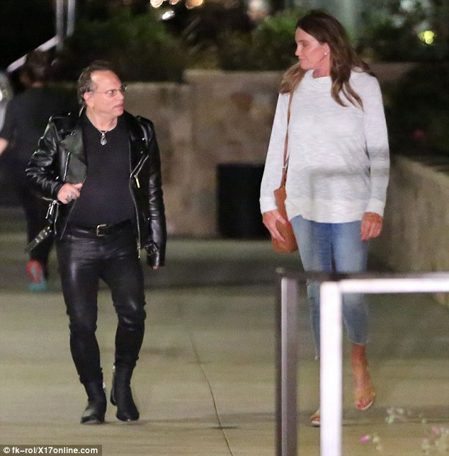 Keeping his cool: Father-of-three Buzz sported skintight leather pants and a trendy biker jacket, which was teamed with a black T-shirt and sturdy boots