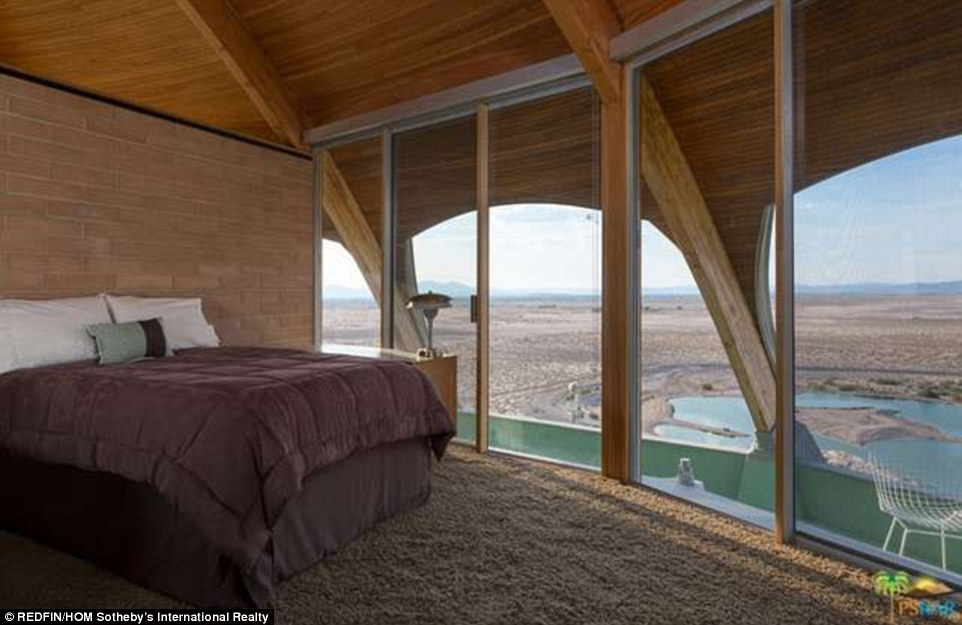 The view from this bedroom looks over at the man-made lake that also sits on the property