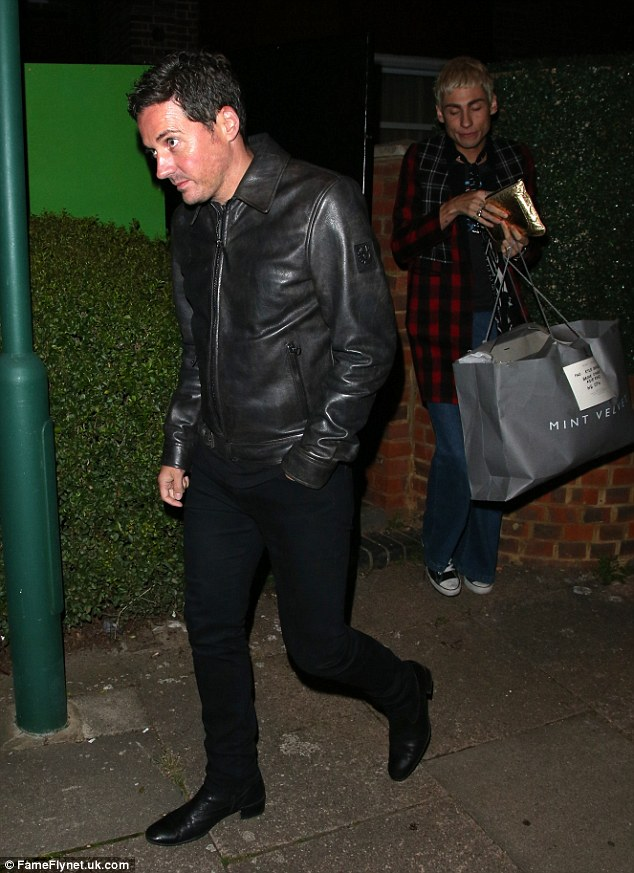 Classic style: Dave donned a black leather jacket with black skinny jeans and black brogue shoes