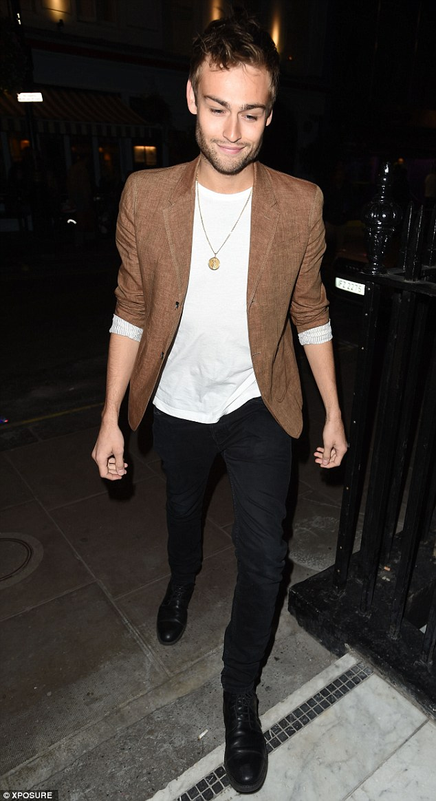Very suave: Douglas Booth looked sharp in tight black jeans and a brown blazer