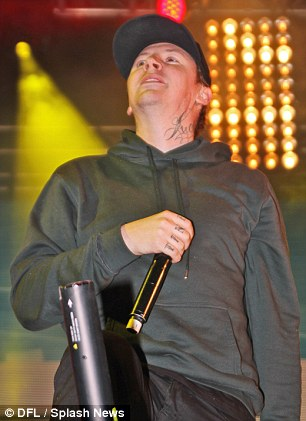 Stand-out performance: The rapper was seen singing his heart out as he performed wearing black jeans, a slate grey hoodie, a black cap and a pair of New Balance trainers