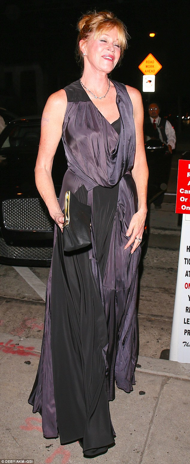 Breezy evening: Her only accessories were a basic black clutch with gold piping and a three jewel silver necklace