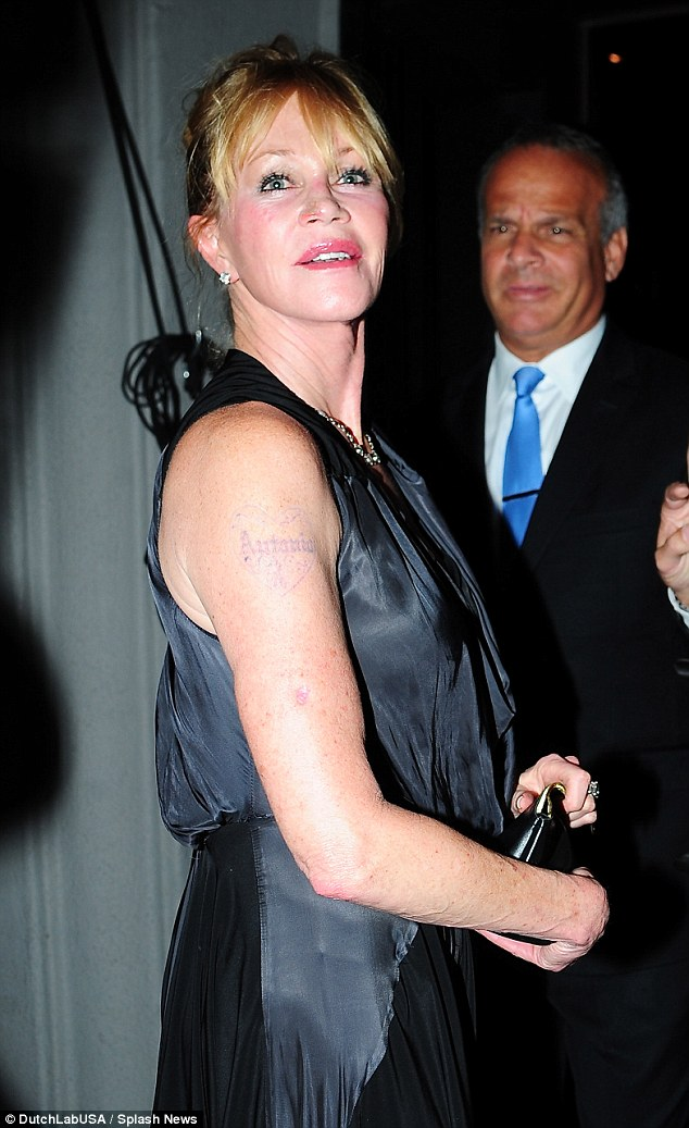 Bad memories:revealed by the lack of sleeves was the Hollywood legend's now faded 'Antonio' tattoo, of course referring to her now ex-husband Antonio Banderas
