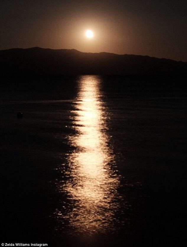 Moving message: On Saturday Robin Williams's daughter Zelda posted this Instagram snap of the moonrise over a lake with a caption urging folks suffering depression from a loss to 'hold on for the possibility of hope'