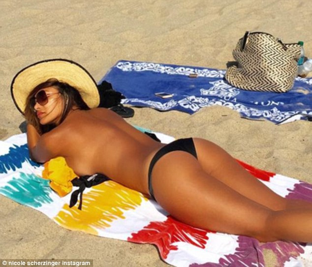 Lazy summer days: The 37-year-old star indulged in some beach time last week