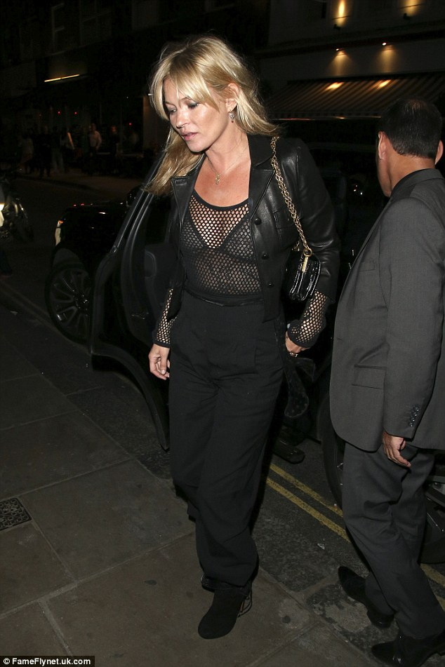 Daring: The Croydon native flashed her bra in a sheer mesh top, which she styled with a pair of black trousers