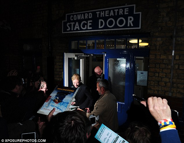 Heading home: The Australian star was greeted by a roaring crowd as she left the theatre