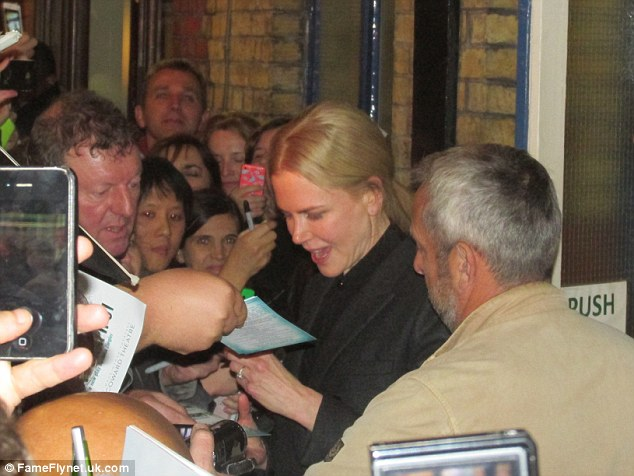 All part of the job! The Oscar winner was animated as she signed autographs for the people waiting outside the theater