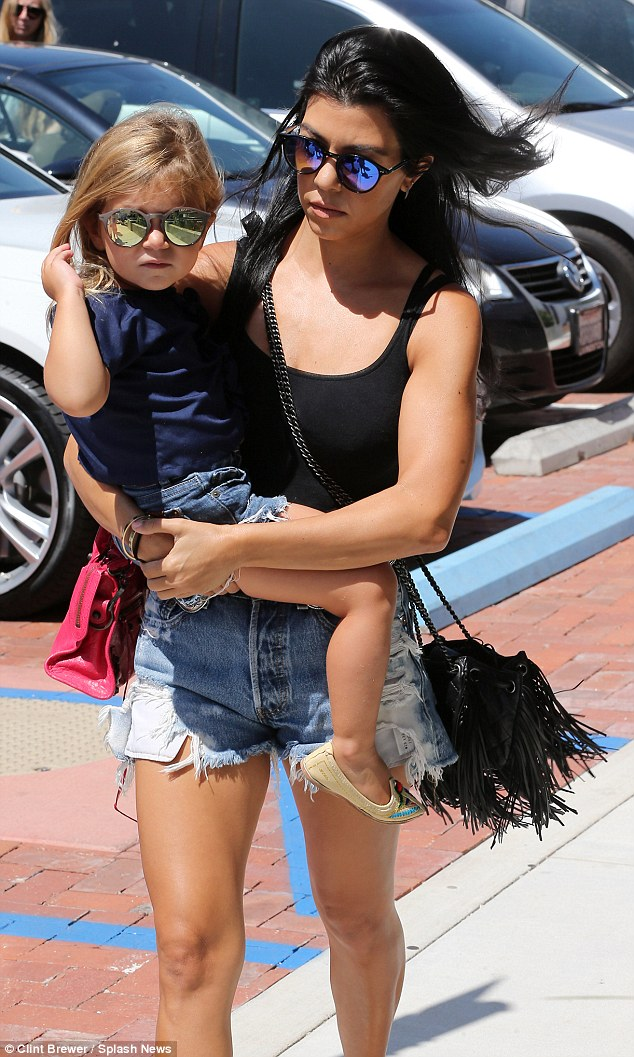 Mother-daughter style: Penelope and Kourtney wore matching reflective sunglasses as they stepped out in Malibu