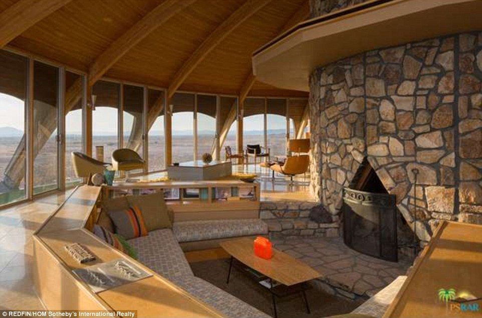 High curved ceiling and glass doors optimize the 2,206 sq ft property's stunning desert backdrop