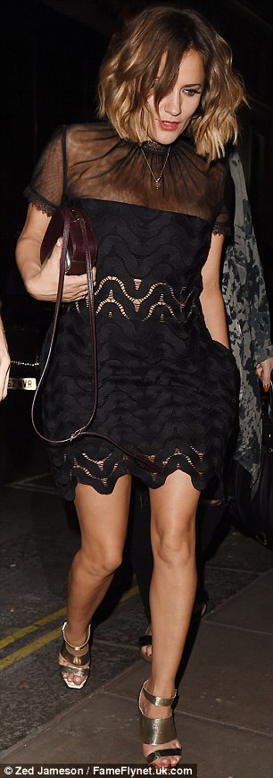 Standing tall:The sexy number, which boasted a semi-sheer bodice and lace cut-out detail, was styled further with a burgundy leather handbag and gold strappy heels