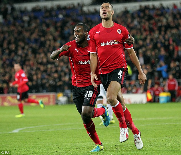 Bluebird buddy: Odemwingie has maintained his friendship with Cardiff captain Steven Caulker, here celebrating his goal against Swansea with Kevin Theophile-Catherine