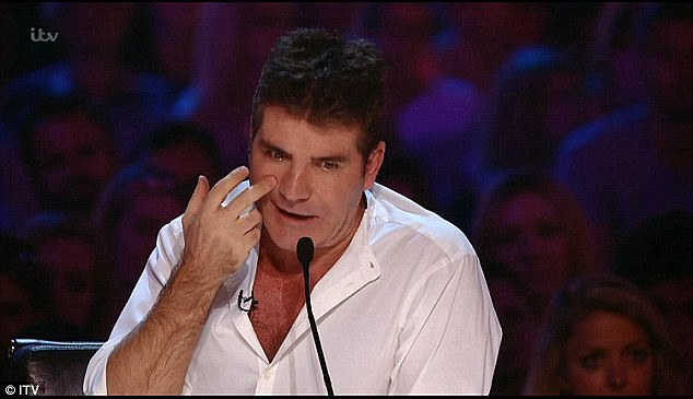 Sad moment: While watching Josh Daniels' rendition of Labrinth's Jealous, Simon was seen wiping away tears, before walking backstage and swiftly giving his microphone back