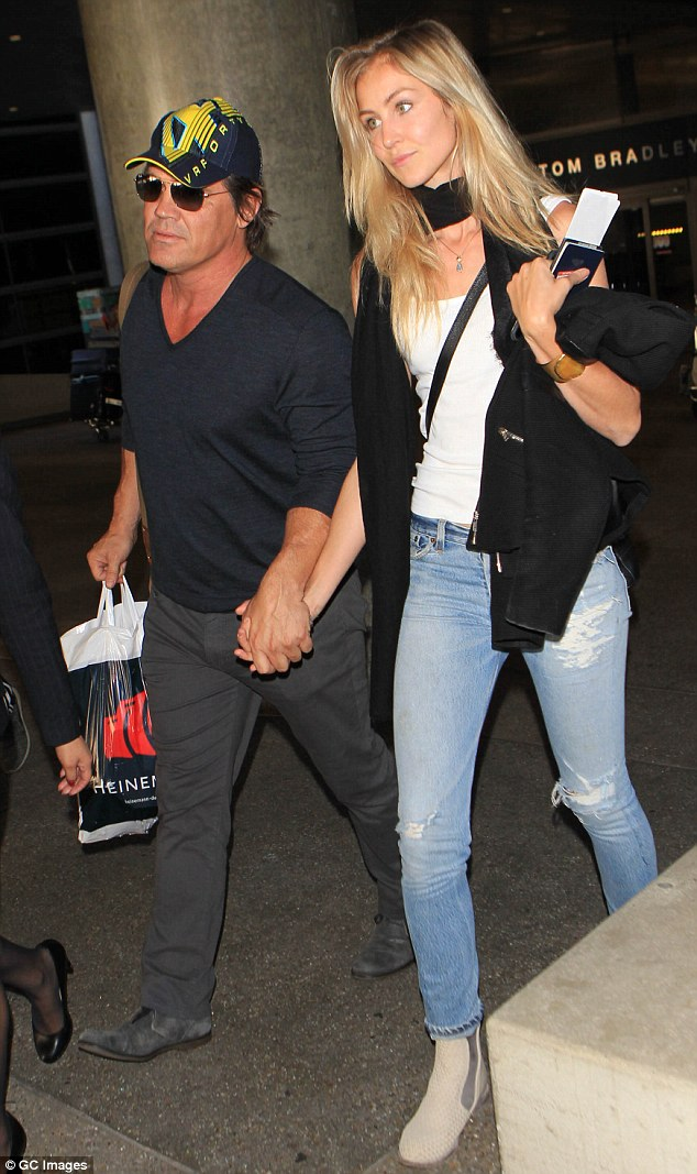 Low-key love: Josh Brolin held hands with his fiancée Kathryn Boyd when they landed in LAX on Friday