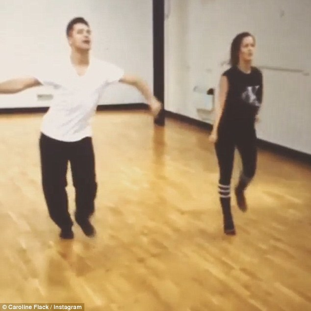 Motivation: Shaking her hips alongside the dancing pro, the star wrote: 'Nearly ready for launch day!!!! Keeping up with pashas hips.... HARD WORK'