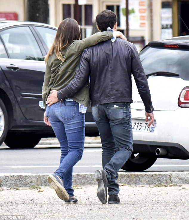 Inseparable: The couple walked arm-in-arm as they strolled through the popular French city