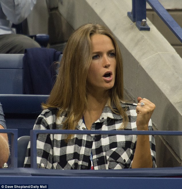 Kim Murray opted for a laid back lumberjack shirt as she cheered on her husband Andy on day six of the US Open at the USTA BIllie Jean King National Tennis Center in New York
