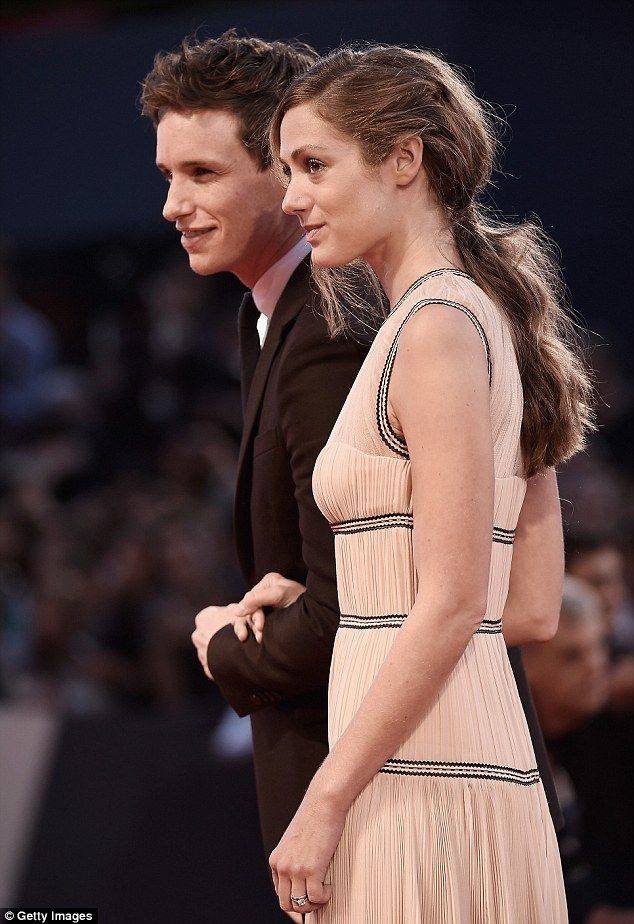 Cute twosome: She clung faithfully to his arm, as she had done when he won his Oscar earlier this year