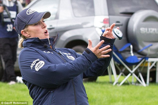 Catch! The royal, who is married to rugby star Mike Tindall, was happy to throw around a tiny rugby ball