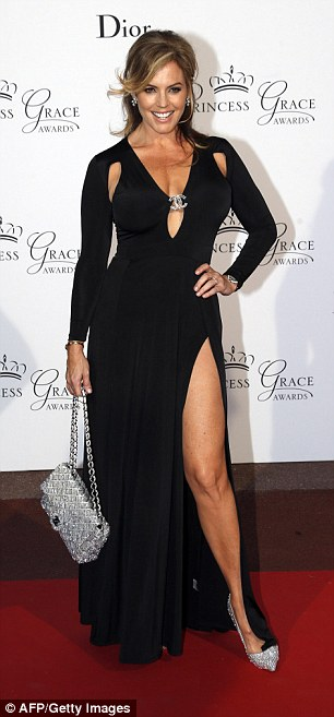 US actress and model Sandra Taylor poses on the red carpet as she arrives for 2015 Princess Grace Awards Gala