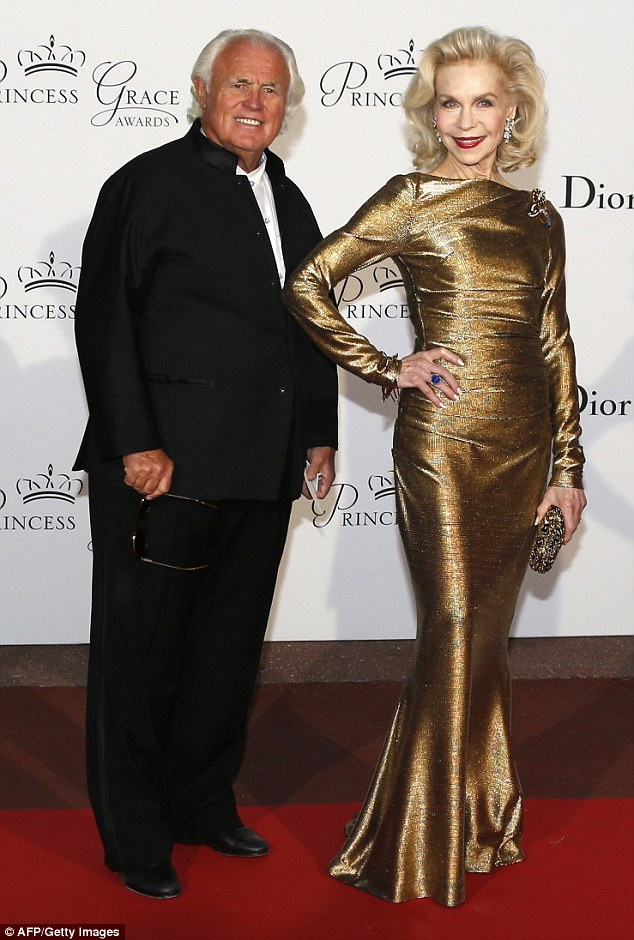 US socialite Lynn Wyatt and Yves G Piaget, chairman of Swiss luxury watchmakers and jewellers brand Piaget, pose on the red carpet