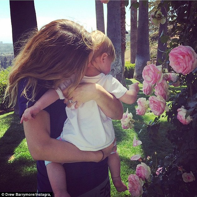 Motherhood: The 40-year-old shared an Instagram photo of herself nuzzling her daughter Frankie
