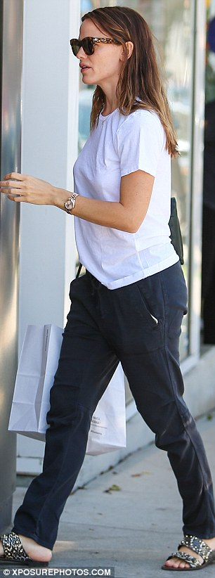 Casual: The Alias actress dressed her slim figure in a white T-shirt and black cargo trousers