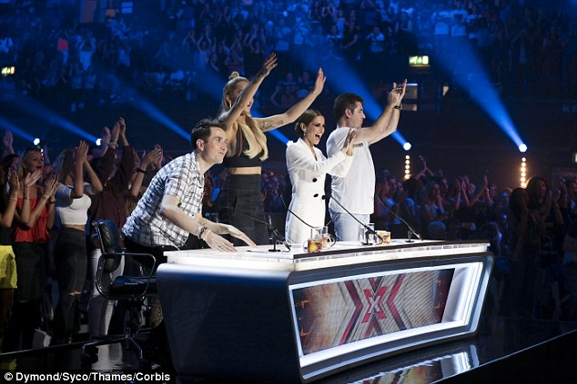 Impressed: Simon Cowell is desperate to claw back ratings this year and producers, convinced that Britain's talent pool is drying up, have left no stone unturned